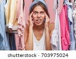 nervous woman keeping hands on...   Shutterstock . vector #703975024