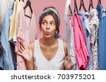 attractive woman dressed... | Shutterstock . vector #703975201