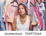 cute european woman wearing...   Shutterstock . vector #703975264
