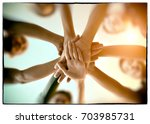 young group are join hands for... | Shutterstock . vector #703985731