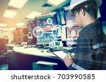 double exposure of engineer or...   Shutterstock . vector #703990585