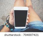 smart phone on hand | Shutterstock . vector #704007421
