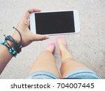 smart phone on hand | Shutterstock . vector #704007445