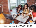 female office workers planning... | Shutterstock . vector #704014159