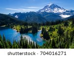 mount rainier and eunice lake... | Shutterstock . vector #704016271