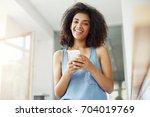 beautiful african girl smiling... | Shutterstock . vector #704019769