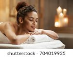beautiful african girl resting... | Shutterstock . vector #704019925