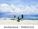back view of young male and... | Shutterstock . vector #704021131
