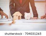 housing company good teamwork ... | Shutterstock . vector #704031265