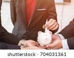 asian business investors...   Shutterstock . vector #704031361