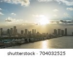 view of miami in the evening... | Shutterstock . vector #704032525
