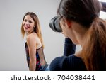 young woman pretending to be a... | Shutterstock . vector #704038441