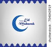 illustration of eid mubarak... | Shutterstock .eps vector #704043919