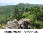 rocks and hills. valley of... | Shutterstock . vector #704044981