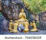 buddha statues in mount phou si ... | Shutterstock . vector #704058109