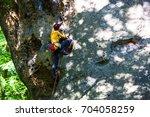 sports girl climbs on the rock. ... | Shutterstock . vector #704058259
