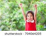 happy asian child girl in... | Shutterstock . vector #704064205