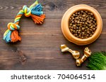 Stock photo large bowl of pet dog food with toys on wooden background top view mockup 704064514
