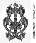 celtic dragons tattoo and t... | Shutterstock .eps vector #704065264