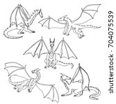 dragons doodle hand drawn set.... | Shutterstock .eps vector #704075539