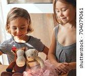 the children performed the...   Shutterstock . vector #704079061