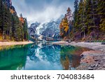 great morning view of braies... | Shutterstock . vector #704083684
