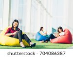 group of asian college student... | Shutterstock . vector #704086387
