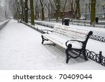 Snow On Bench In Park Of Winter.