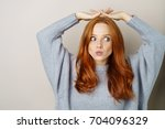 cute playful young redhead... | Shutterstock . vector #704096329