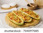 stuffed zucchini with chicken ... | Shutterstock . vector #704097085