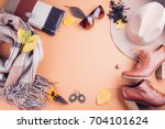 Stock photo autumn female outfit set of clothes shoes and accessories on brown background 704101624