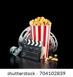 popcorn  cinema reel ...   Shutterstock . vector #704102839