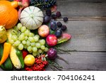 autumn fruits and vegetables...   Shutterstock . vector #704106241