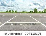 empty parking lot against a...   Shutterstock . vector #704110105