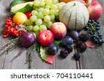 autumn fruits and vegetables on ...   Shutterstock . vector #704110441