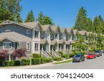 Street of new townhouses with...
