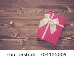 red new year or christmas gift... | Shutterstock . vector #704125009