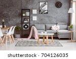 wooden coffee table near grey... | Shutterstock . vector #704126035
