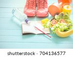 healthy eating  workout and... | Shutterstock . vector #704136577