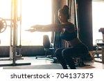 young asian woman in sportswear ... | Shutterstock . vector #704137375