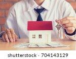 salesman home brokers holding... | Shutterstock . vector #704143129