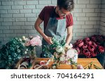 young male florist working at... | Shutterstock . vector #704164291