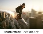 man on a rocket above new york... | Shutterstock . vector #704186779