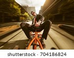 businessman on pedal car | Shutterstock . vector #704186824