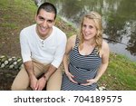 happy young pregnant couple... | Shutterstock . vector #704189575