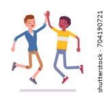 young men jumping giving high...   Shutterstock .eps vector #704190721