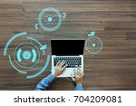 hand working with sci fi... | Shutterstock . vector #704209081