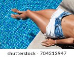 shot of an attractive young... | Shutterstock . vector #704213947