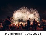 people watching fireworks | Shutterstock . vector #704218885