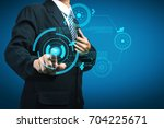businessman touching sci fi...   Shutterstock . vector #704225671